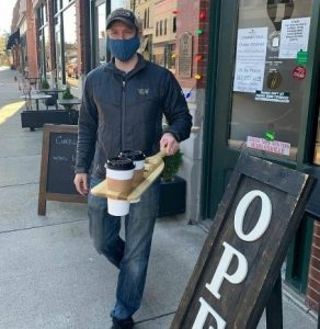 Noble Coffee & Tea delivering coffee via a modified paddle
